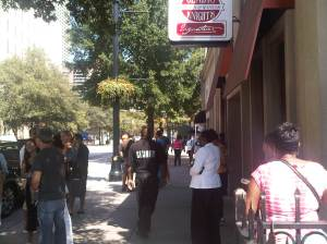 Security guard keeps order outside of Gladys' and Ron's Chicken and Waffles in Downtown Atlanta. Photo by Above Promotions Company. Tampa, FL 2012.
