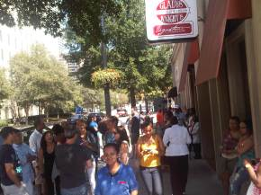 The lunch crowd waiting for their tables inside of Gladys' and Ron's Chicken and Waffles in Downtown Atlanta. Photo by Above Promotions. Tampa, FL 2012.