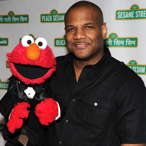 Elmo and Kevin Clash. Photo Courtesy of Bryan Bedder and Getty Images. Above Promotions Company. Tampa, FL