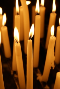 Candles to remember the innocent victims of the shootings that occurred in public places in the U.S. in 2012. Photo Courtesy of Irum Shahid. Above Promotions Company, Tampa, FL 2012.